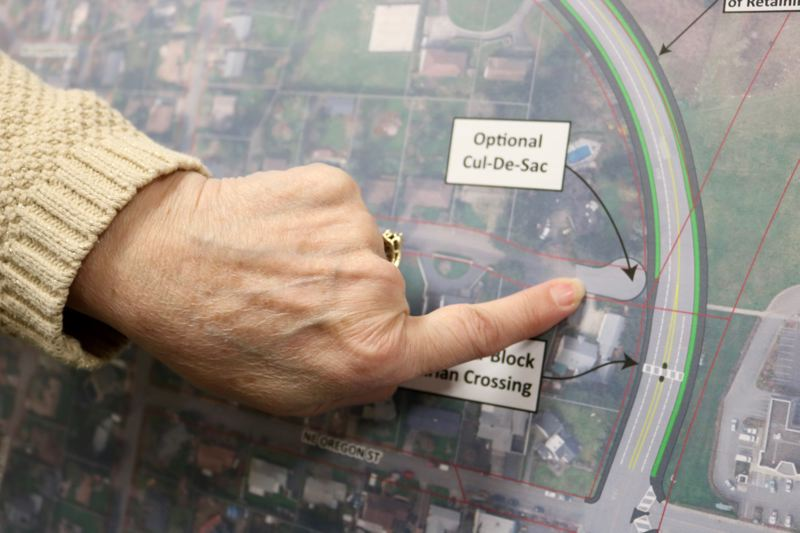 OUTLOOK PHOTO: ZANE SPARLING - A resident points toward an optional new cul-de-sac on Northeast Holladay Street proposed by Multnomah County planners.