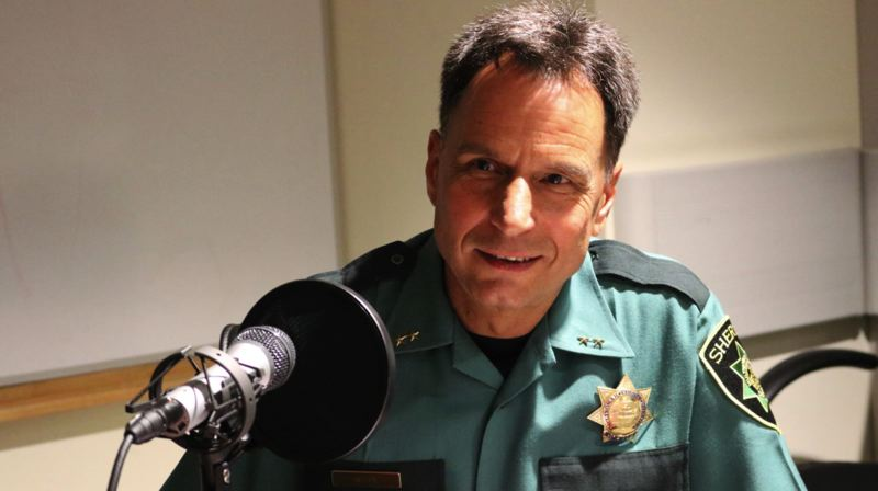 COURTESY PHOTO - Multnomah County Sheriff Mike Reese speaks into a microphone in an undated photograph.
