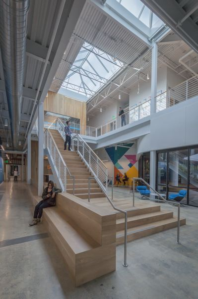 COURTESY: SERA ARCHITECTS - LinkedIn Middlefield Campus: Wood feature stairs, gathering spaces and extensive skylights encourage activity and collaboration in the social zones of each lobby.
