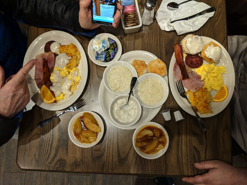 TRIBUNE PHOTO: JOSEPH GALLIVAN  - Typical country coooking at Cracker Barrel includes gravy, grits and hog products, which partially accounts for its cult status. Management claims that the welcoming atmosphere where people are not hustled out in order to turn tables also builds for loyalty. Diners order from servers carrying tablets, but they pay on the way out in the gift shop. There they are more likely to make extra purchases, since they only have to run their credit card once.