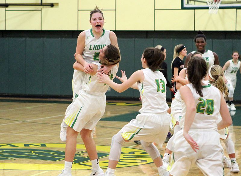 TIDINGS PHOTO: MILES VANCE - West Linn senior Kennedi Byram gets lifted into the air at the end of her team's 43-39 win over Oregon City in the second round of the Class 6A state playoffs at West Linn High School on Friday.