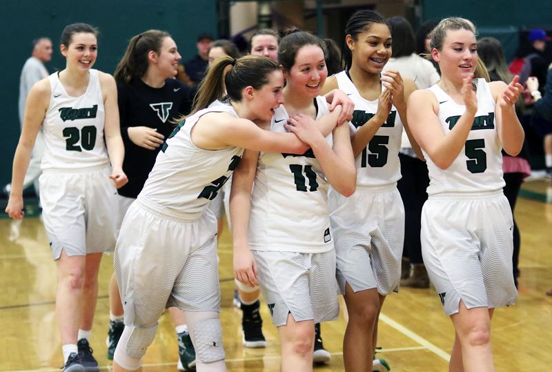 DAN BROOD - Tigard players, including (from left) Caitlin Erickson, Hannah Jedan, Delaney Leavitt, Paige LaFountain, Ajae Kadel and Gabby McGaughey are all smiles following the Tigers' 51-48 state playoff win over Grants Pass on Friday.