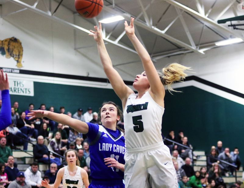 DAN BROOD - Tigard senior Gabby McGaughey (5) shoots a jumper during the win over Grants Pass.