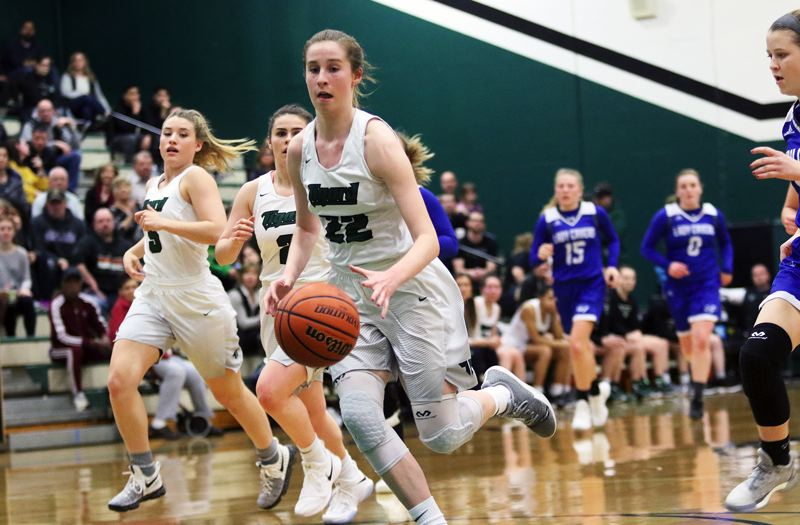 DAN BROOD - Tigard sophomore Delaney Leavitt leads a fast break during the state playoff win over Grants Pass on Friday.