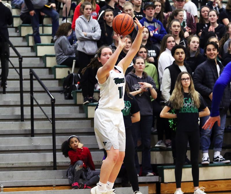 DAN BROOD - Tigard junior Paige LaFountain shoots a 3-pointer during Friday's state playoff game.