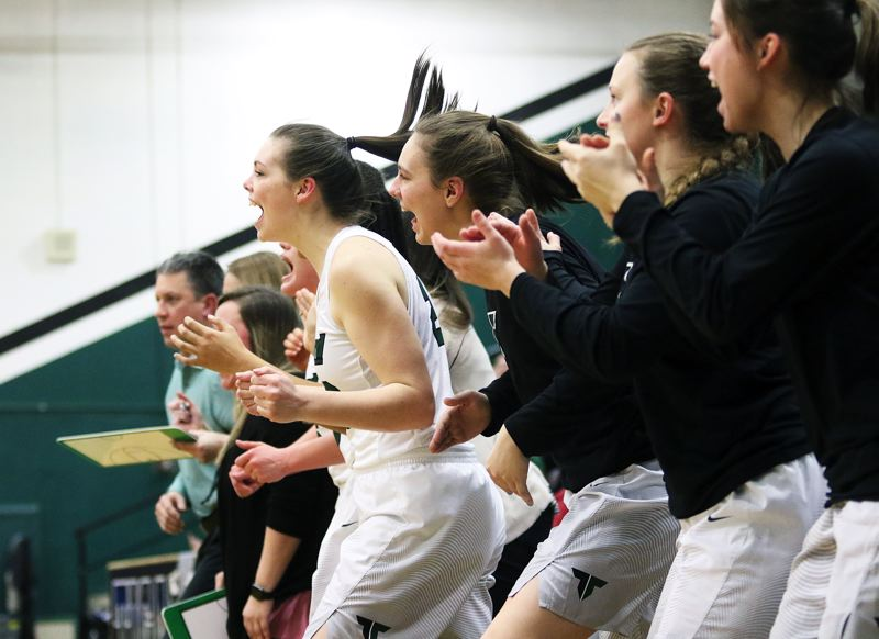 DAN BROOD - Tigard players, including Caitlin Erickson, Hannah Jaden, Kelsie Boschman and Lexi Klum cheer on their teammates during Friday's state playoff contest.