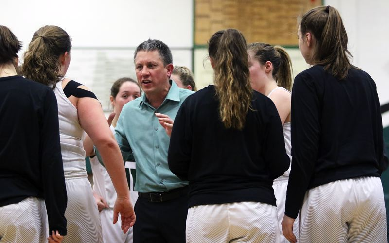 DAN BROOD - Tigard coach Steve Naylor talks to his team during a timeout in Friday's Class 6A state playoff second-round contest.