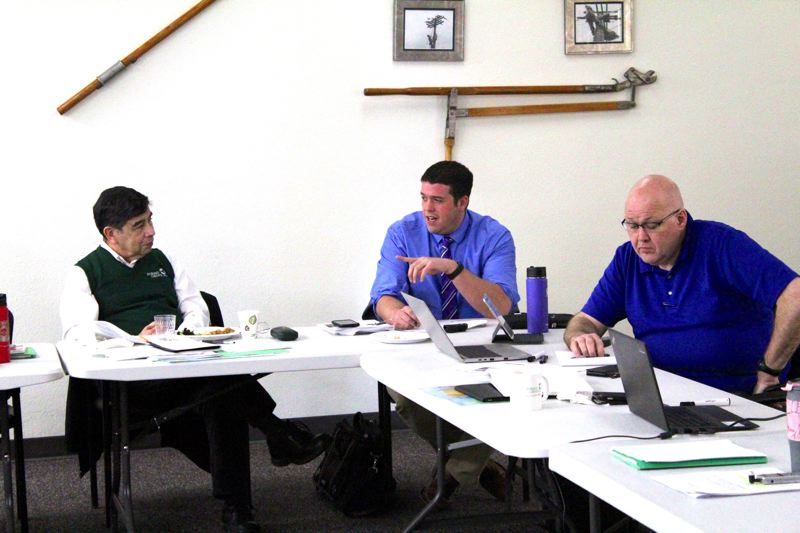 STAFF PHOTO: MARK MILLER - Bryan Pohl (center), Forest Grove's community development director, responds to input from City Councilor Val Valfre (left) at a work session Saturday. Also pictured: Paul Downey, Forest Grove's administrative services director.