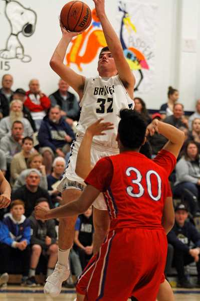 STAFF PHOTO: WADE EVANSON - Banks' Blake Gobel goes up for a shot during the Braves' playoff game against Madras March 3 at Banks High School.