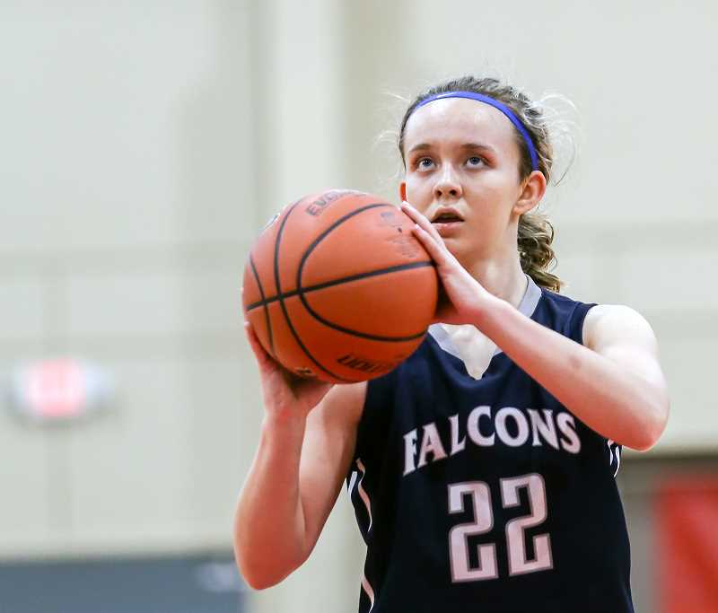 COURTESY PHOTO: KATHY ANEY - Faith Bible's Anna Goodloe studies a free throw attemptduring the Falcons' state semifinal game against Kennedy March 2 at the Pendleton Convention Center.