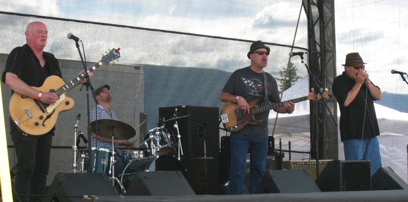 SUBMITTED PHOTO - The Suburban Slim Band, here playing the Naked Winery in Hood River, is coming to Oak Grove in March.