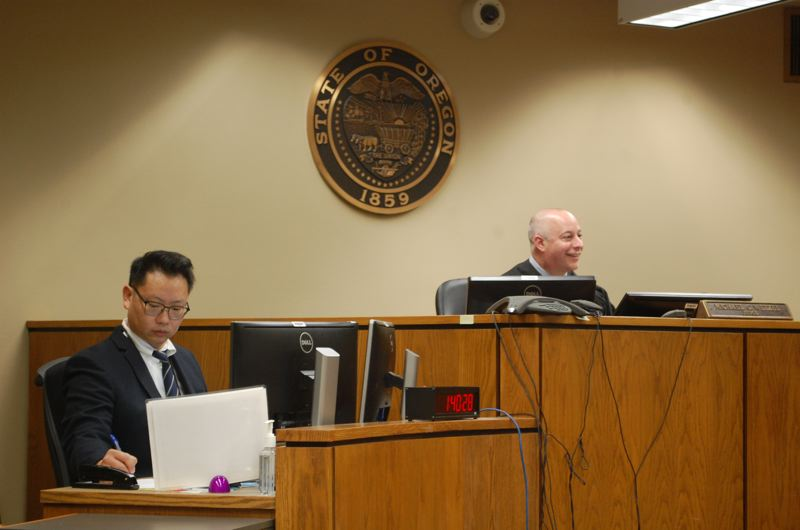 PHOTO BY: RAYMOND RENDLEMAN - Judicial Clerk Paul Kim and Clackamas County Circuit Judge Michael Wetzel review a recent case at the courthouse in Oregon City.