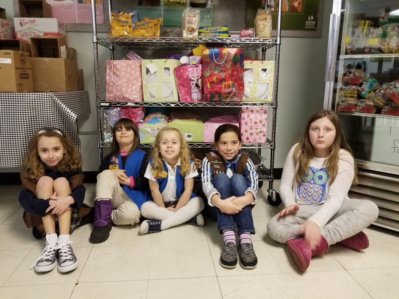 PHOTO COURTESY: LESLIE ROBINETTE - Girl Scout Service Unit 11 donated to the Gladstone Food Pantry. The troop includes Alaina Brougher, Daphne Scherer, Brianna Brougher, Cassidy Nelson and Autumn Brown.