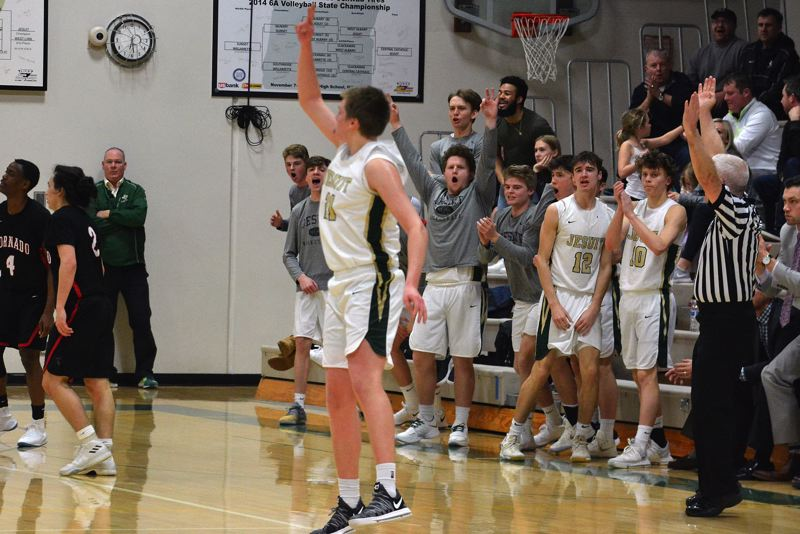 TIMES PHOTO: MATT SINGLEDECKER - Jesuit senior Joe Wall and the Crusader bench celebrate a huge Wall three-pointer versus North Medford.
