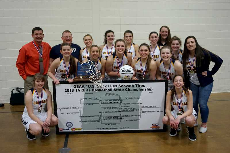 PHOTO COURTESY OF LAURA WARRINGTON - Country Christian's girls' basketball team has won the 2018 Class 1A State Championship after beating Nixyaawii 56-54 in a nail-biting finish that came down to the final seconds.This is the Cougars' second state title in three years, and it ends a 56-game winning streak for Nixyaawii.