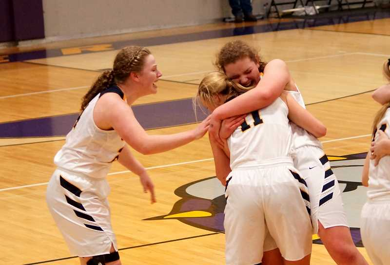 PHOTO COURTESY OF LAURA WARRINGTON  - Country Christian seniors Meghan McGrath (left), Mollie Lewandowski (back right), and Anna Farner (frontright) embrace in a hug after winning the state title Saturday.