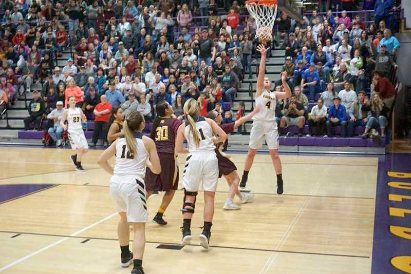 PHOTO COURTESY OF LAURA WARRINGTON  - Country Christian senior Mollie Lewandowski, (4) sends in the go-ahead layup assisted by senior AnnaFarner with 3.1 seconds left to take a two-point lead. Lewandowski scored 26 points in the title game andwas unanimously named the Class 1A Player of the Year.