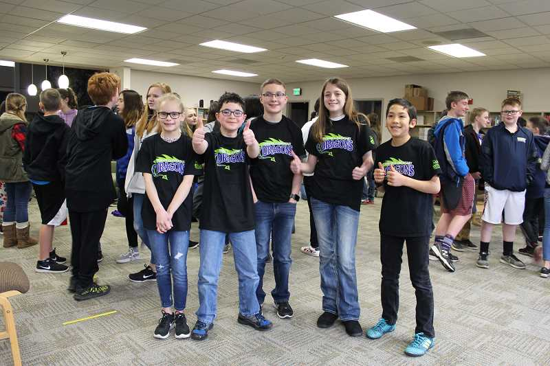 HERALD PHOTO: KRISTEN WOHLERS - The winning team, the Knowledge Knights, are from left to right: Mollie Moore, Keegan Mundis, Brayden Boley, Rachel Windham and Evan Kinzie.