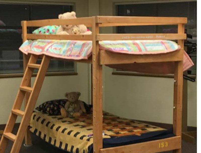 SUBMITTED PHOTO - Hand-crafted bunk beds come with a new mattress and sheets and a specially made quilt; over 300 children in Clackamas County have received beds from the Bunk Bed Ministry.