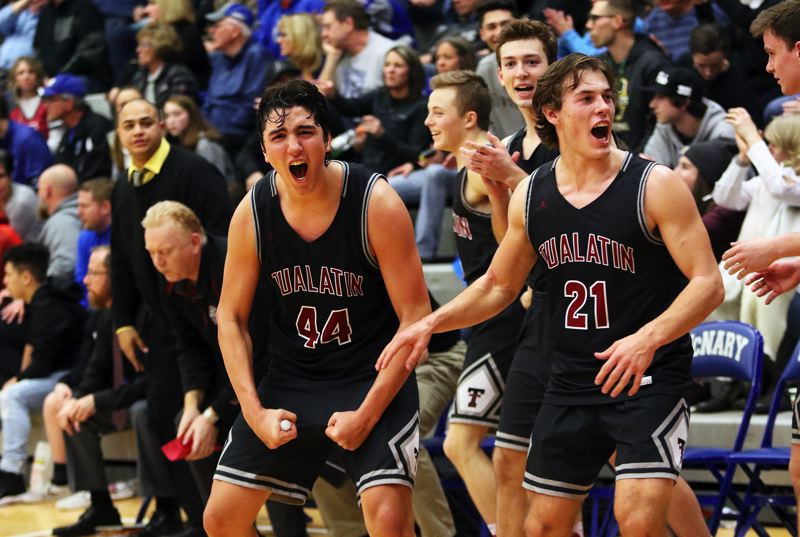 DAN BROOD - Tualatin junior Bridger Steppe (44) and senior Lucas Noland rejoice following the Timberwolves' state playoff win at McNary on Saturday.