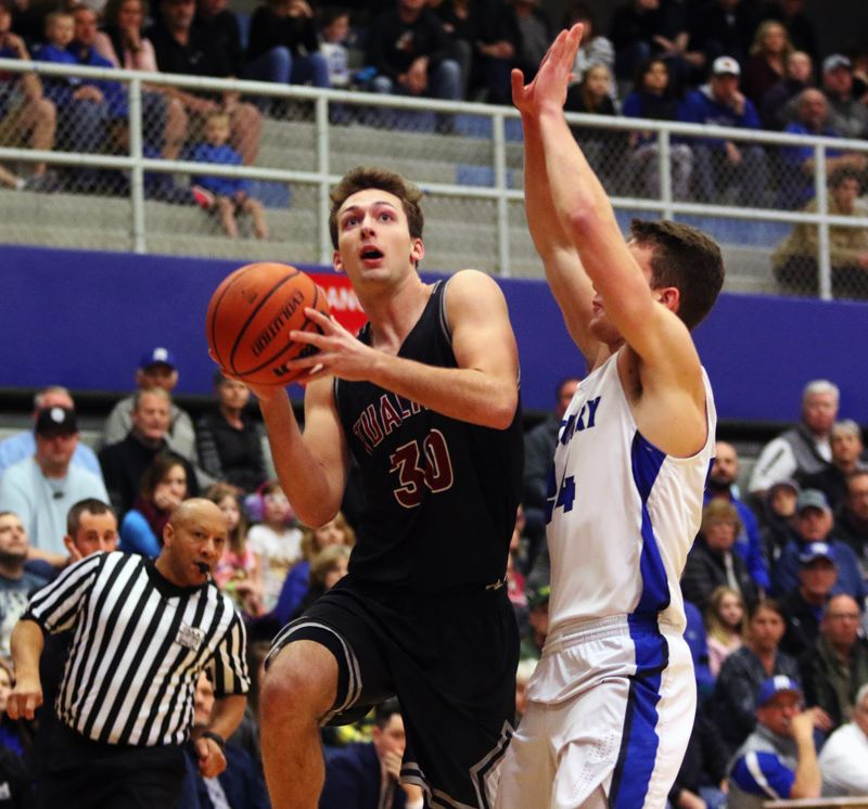 DAN BROOD - Tualatin senior Chris Freese (left) looks to go to the basket during Saturday's state playoff game at McNary.