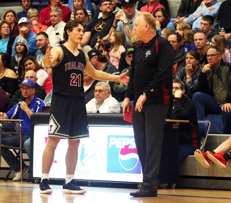 DAN BROOD - Tualatin senior Lucas Noland talks to Timberwolf head coach Rick Osborn during Saturday's state playoff game at McNary.