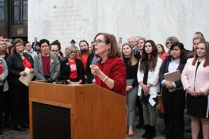 REVIEW PHOTO: PARIS ACHEN - Gov. Kate Brown addresses a crowd of students, gun safety advocates and survivor families Monday at a rally outside the state Capitol in Salem. More than 200 students from Lakeridge and Lake Oswego high schools urged the governor to tighten gun laws and improve school safety.
