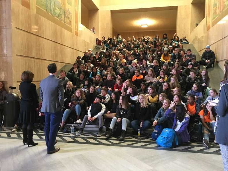 REVIEW PHOTO: CLAIRE HOLLEY - State Rep. Andrea Salinas and state Sen. Rob Wagner meet with students from Lakeridge and Lake Oswego high schools Monday in Salem. 'Make sure you stay engaged and never give up,' Wagner told the group.