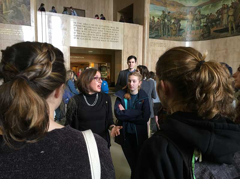 REVIEW PHOTO: CLAIRE HOLLEY - State Rep. Andrea Salinas meets with Lake Oswego students Monday in the Capitol rotunda to hear their pleas for improved school safety. Said LOHS senior Greta Burton, 'I think our presence sent a strong message.'