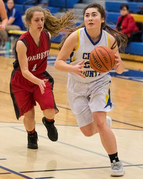 CENTRAL OREGONIAN FILE PHOTO - Emma Ackley goes to the hoop for a fast break layup during the Cowgirls' home victory over the Corbett Cardinals. The game was one of five wins on the season for Crook County.