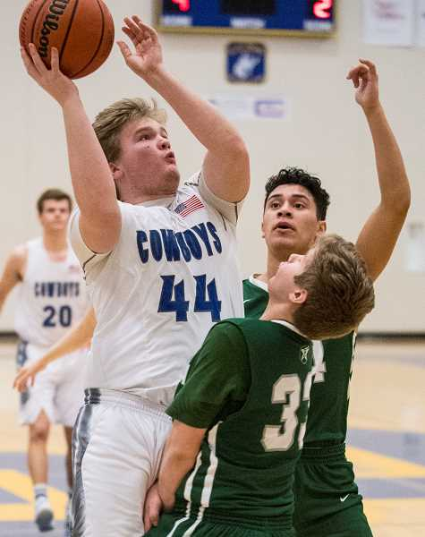 CENTRAL OEGONIAN FILE PHOTO - Will Combee goes up for a basket during the first half of the Tri-Valley Conference play. Combee, a senior, was injured early in the league season and played sparingly the remainder of the year.