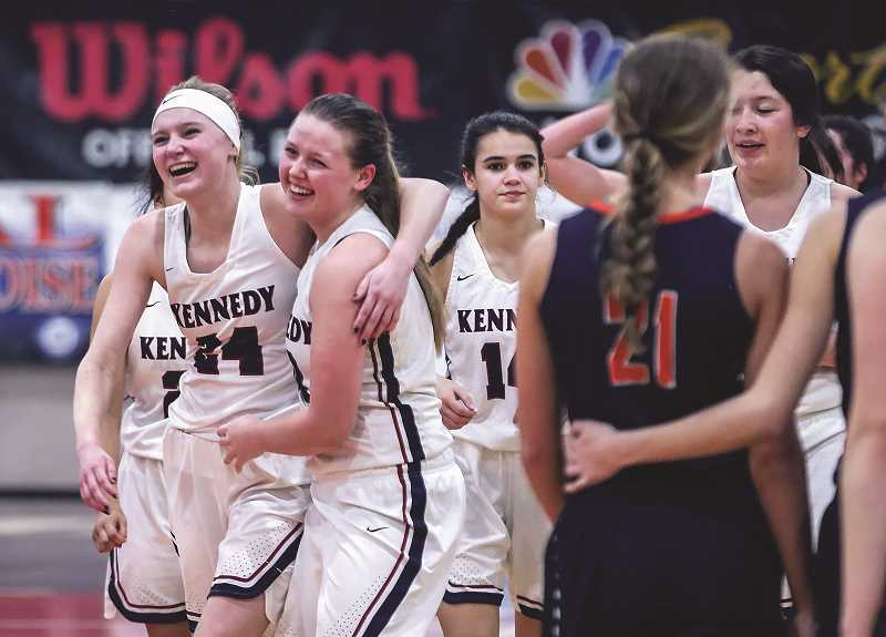 KATHY ANEY - EAST OREGONIAN - The Kennedy girls basketball team walks off the floor moments after beating the Monroe Dragons 53-40 to win the 2018 2A State Championship on Saturday at the Pendleton Convention Center.