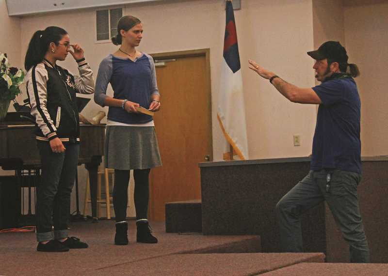 INDEPENDENT FILE PHOTO - Christopher Leebrick directs students acting out a scene during a rehearsal last year.