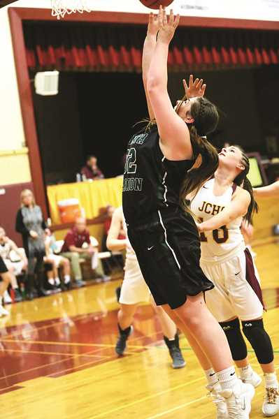 JO WHEAT - Senior Hannah Kinniburgh pulls down a rebound in the team's 47-21 win over the Tigers.