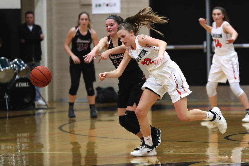 JAIME VALDEZ - Beaverton sophomore Sydney Erikstrup (right) and Sherwood junior Alex Verkamp race for a loose ball during Friday's state playoff game.
