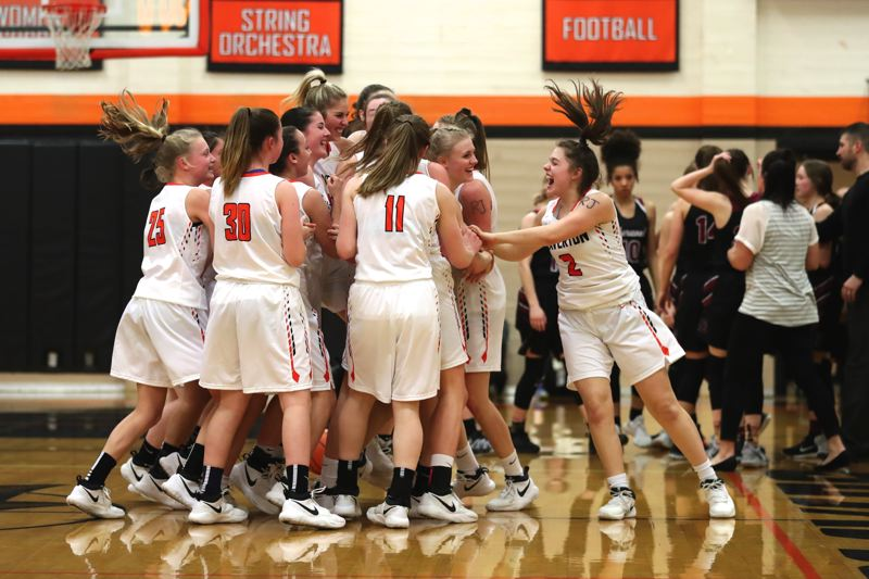 JAIME VALDEZ - The Beaverton girls basketball team celebrates following its 25-18 win over Sherwood in Friday's Class 6A state playoff second-round game.