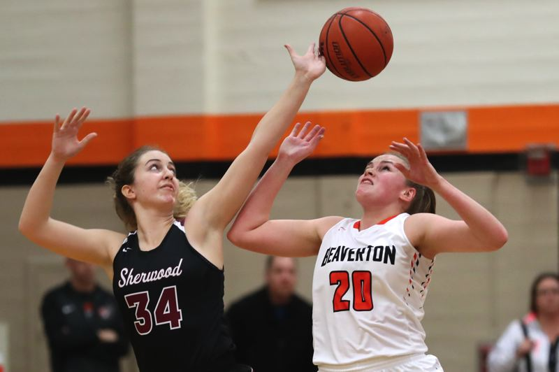 JAIME VALDEZ - Sherwood junior post Cali Etherington (left) and Beaverton sophomore Laura Erikstrup battle for the ball during Friday's state playoff game.