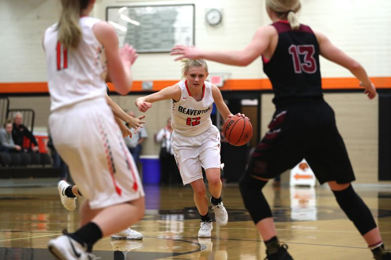 JAIME VALDEZ - Beaverton sophomore Mary Kay Naro (12) gets the ball up court during Friday's Class 6A state playoff game.