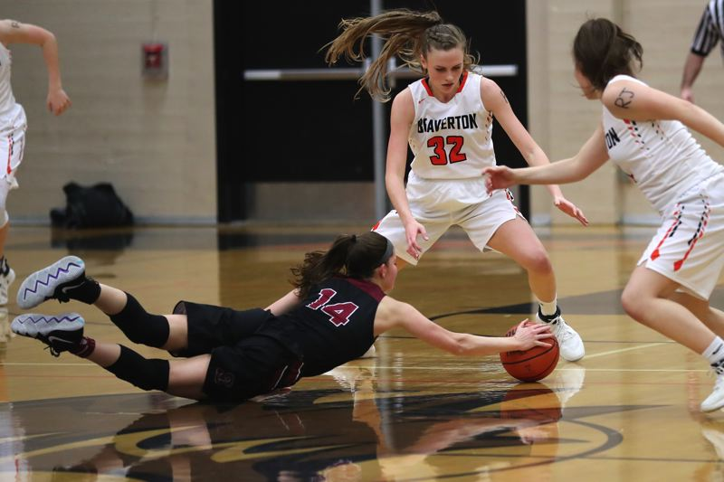 JAIME VALDEZ - Sherwood junior Alex Verkamp (14) dives for a loose ball in front of Beaverton sophomore Sydney Erikstrup.