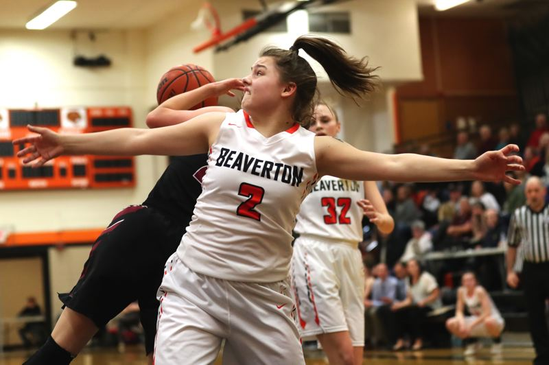 JAIME VALDEZ - Beaverton freshman Mackenzie Naro tries to box out on a rebound during Friday's state playoff game with Sherwood.