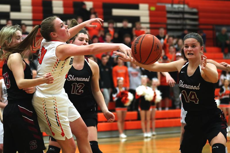 JAIME VALDEZ - The ball is up for grabs between Beaverton sophomore Laura Erikstrup (left), Sherwood junior Kaytlin Cooke (12) and Sherwood junior Alex Verkamp.