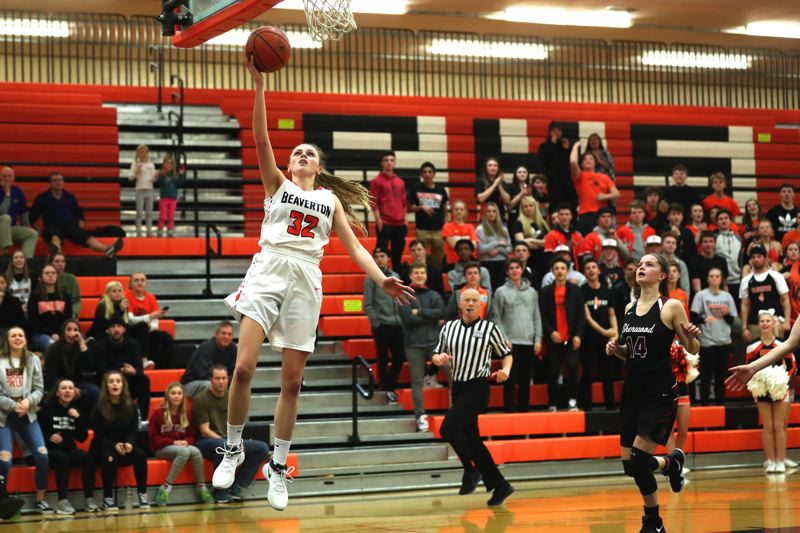JAIME VALDEZ - Beaverton sophomore Sydney Erikstrup goes up for a layup late in the third quarter of Friday's Class 6A state playoff game.