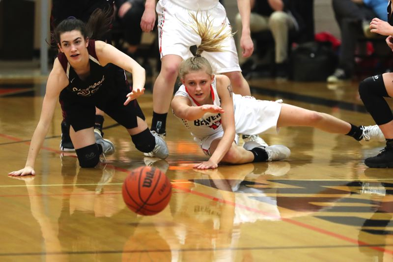 JAIME VALDEZ - The ball is loose and on the court in front of Sherwood sophomore Julia Leitzinger (left) and Beaverton sophomore Mary Kay Naro.