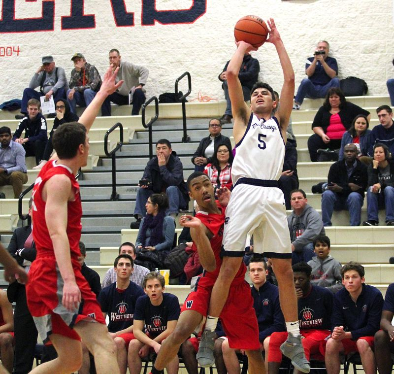 REVIEW PHOTO: MILES VANCE - Lake Oswego senior J.R. Schilling (shown here against Westview) scored 18 points during his team's 82-81 double-overtime loss to Lincoln in the second round of the Class 6A state playoffs at Lake Oswego High School on Saturday.