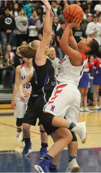 WILL DENNER/MADRAS PIONEER - Kaliyah Iverson draws contact while going up for a shot in the paint.