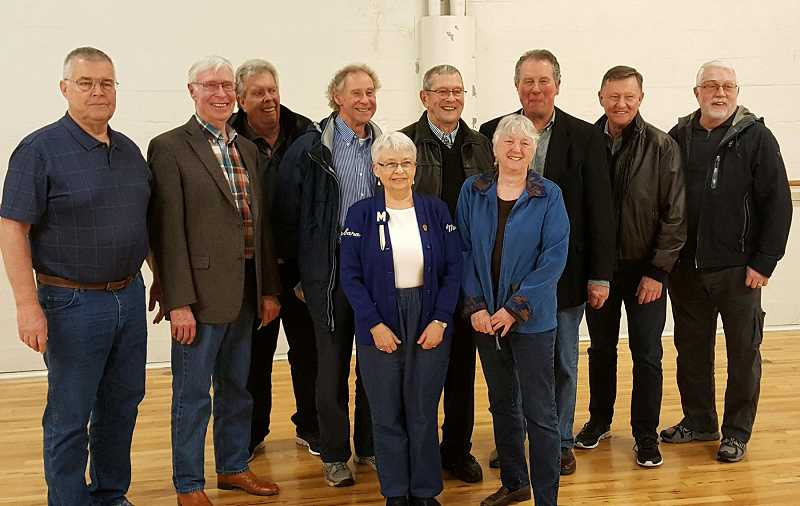 SUBMITTED PHOTO - Members of the 1961 Madras boys basketball team were on hand in Coos Bay last weekend to be honored at the 3A state basketball tournament at Marshfield High School, where the team won the A-2 championship.  Among those in attendance were, back row, from left to right, Gerry Galbraith, Gregg Macy, Alan Stewart, Tom Clark, coach Ole Johnson, Joe Piedmont, Phil Stevenson and Dennis Miller. In the front row are two Madras cheerleaders from 1961 — Barbara Grant (left) and Patti Miller (right).