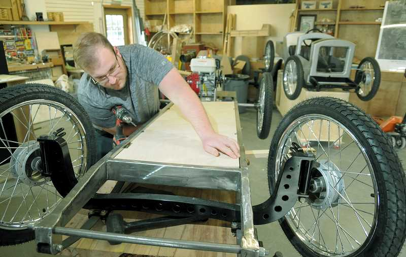 GARY ALLEN - Eighteen-year-old Eli Lindquist works on his cycle cart at Anvil Academy in Newberg. He began the project in August.