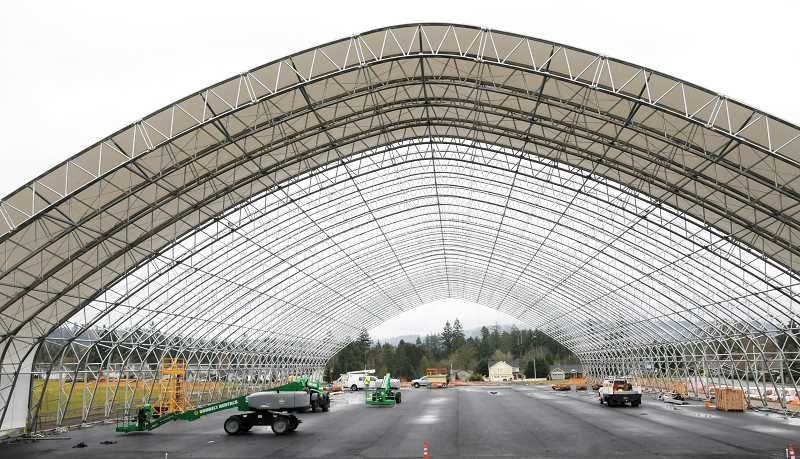 GARY ALLEN - Work crews began installing the PVC-fabric covering for the George Fox University indoor tennis center and multi-use facility last week. The building measures 140 x 320 feet and will include six full tennis courts, a five-lane 100-meter track surface with a jump pit and pole vault box.