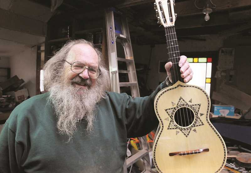 GARY ALLEN - Newberg Music Store owner and musical instrument maker GD Armstrong crafts and repairs guitars, bazookas, mandolins, fiddles and dulcimers from his shop in the foothills of the coast range west of Yamhill.
