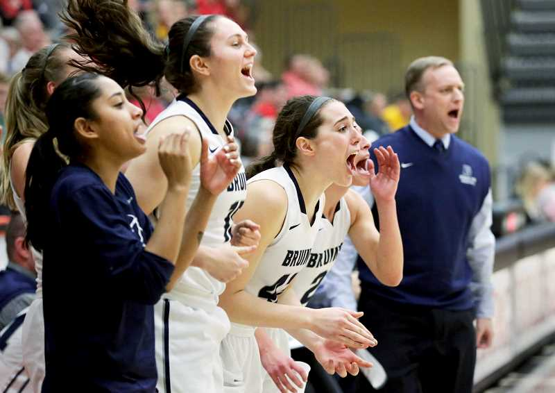 CONTRIBUTED PHOTO -- JULIE DREWES, WARTBURG COLLEGE - The George Fox bench celebrates a play during the Bruins' 79-63 win over St. Benedict in the first round of the NCAA Division III Tournament Friday in Waverly, Iowa.